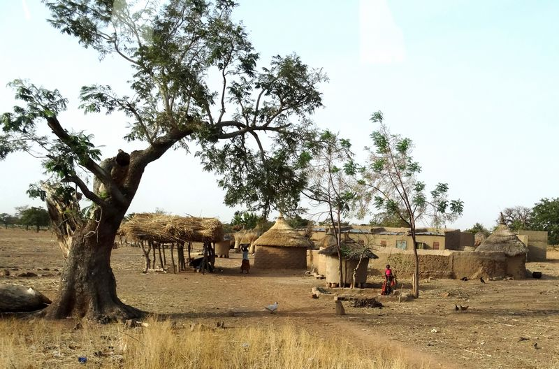 The majority of people in Burkina Faso live in the rural area, many in traditional round mud huts.